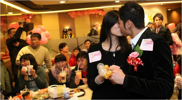 Kelvin Kwong and Ashley Tse at their Feb. 14 engagement party at a McDonald's in Hong Kong.